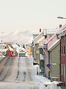 A city bus navigates the streets of Tromso, where wooden houses are commonplace, Tromso, Norway