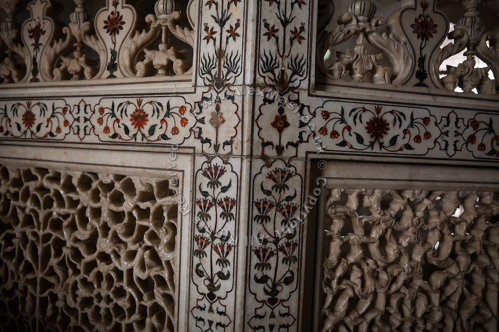Fragile Markana marble surrounds to the tombs of  Mughal emperor Shah Jahan and his third wife, Mumtaz Mahal, in the name of which the Taj Mahal mausoleum was also built and completed around the year 1653, in Agra.