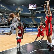 Anadolu Efes's Dogus Balbay (L) during their Turkish Basketball League Play Off match Anadolu Efes between Pinar Karsiyakaat Sinan Erdem Arena in Istanbul, Turkey, Sunday, May 06, 2012. Photo by TURKPIX