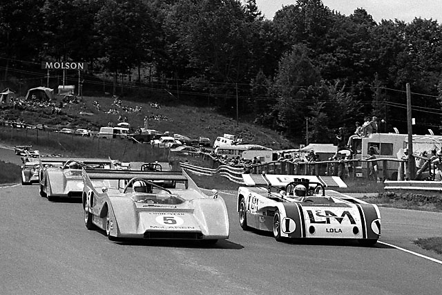 Denny Hulme (McLaren 5) and Jackie Stewart (Lola 1) pace the 1971 St. Jovite Can-Am.