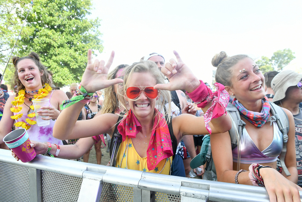 A young woman poses for a photo during The Bonnaroo Music and Arts Festival