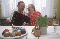 CZECH REPUBLIC MORAVIA BANOV APR98 - Accordeon player Jiri Chovanec plays a tune for an old woman in her home during the Easter Celebrations. jre/Photo by Jiri Rezac<br /> <br /> © Jiri Rezac 1998<br /> <br /> Tel:   +44 (0) 7050 110 417<br /> Email: info@jirirezac.com<br /> Web:   www.jirirezac.com