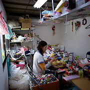 May 29, 2013 - Togura, Japan: A displaced woman works in a newly created arts and crafts business, run by a cooperative of residents in Togura village. The workshop is situated among prefabricated houses used as temporary shelter for families who lost their homes during the devastating earthquake and tsunami that hit the east coast of Japan in 2011. On the third anniversary of the disaster, nearly 270,000 remain displaced. (Paulo Nunes dos Santos)