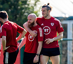 CARDIFF, WALES - Tuesday, September 7, 2021: Wales' captain Gareth Bale (R) and Jonathan Williams during a training session at the Vale Resort ahead of the FIFA World Cup Qatar 2022 Qualifying Group E match between Wales and Estonia. (Pic by David Rawcliffe/Propaganda)