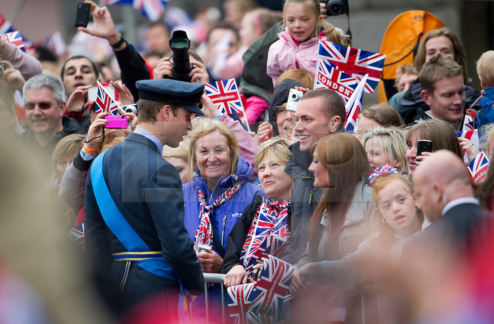 © Licensed to London News Pictures. 03/06/2012. London, UK.  Prince William meeting members of the public before boarding the Royal Barge Spirit of Chartwell during the Jubilee Pageant on the River Thames, London on June 03,2012 as part of The Diamond Jubilee celebrations. Great Britain is celebrating the 60th  anniversary of the countries Monarch HRH Queen Elizabeth II accession to the throne . Photo credit : Ben Cawthra/LNP