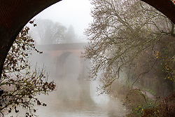 © Licensed to London News Pictures. 07/12/2020. Surrey, UK. A foggy bridge over the River Mole in Leatherhead, Surrey as the Met Office issue a yellow weather warning for freezing fog with disruption to transport for the South East of England this morning. The Government is expected to rolling out the new Pfizer/BioNTech's coronavirus vaccine tomorrow with reports it has already arrived in the UK for distribution to hospitals around the country. Photo credit: Alex Lentati/LNP
