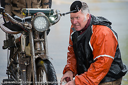 Dean Bordigioni of California on his Class-1 single-cylinder single-speed 1914 Harley-Davidson at a rainy gas stop during the Motorcycle Cannonball Race of the Century. Stage-11 ride from Durango, CO to Page, AZ. USA. Wednesday September 21, 2016. Photography ©2016 Michael Lichter.