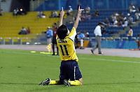 "12/08/04 - THESSALONIKI - GREECE -  - JAPAN OLYMPIC MENS FOOTBALL TEAM -  <br />First match Group B - JAPAN (3) Vs. PARAGUAY (4) -<br />At the THESSALONIKI ""KAFTATZOGLIO STADIUM"".<br />Paraguay  player N*11 AURELIANO TORRES cvelebrating his goal. The four of Paraguay.<br />© Gabriel Piko / Piko-Press"