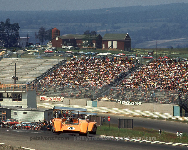 Bruce McLaren leads team mate Denny Hulme in their McLaren M8B cars at the 1969 Watkins Glen Can-Am.