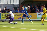 Shrewsbury Town defender Ethan Ebanks-Landell (24) blocking shot from AFC Wimbledon striker Joe Pigott (39) during the EFL Sky Bet League 1 match between AFC Wimbledon and Shrewsbury Town at the Cherry Red Records Stadium, Kingston, England on 14 September 2019.