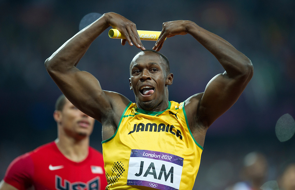 Usain Bolt  of Jamaica celebrates after beating Ryan Bailey  of the US on the finish line to win men's 4x100m final at the London 2012 Olympic Games Athletics, Track and Field events at the Olympic Stadium in London , 11 August 2012. BOGDAN MARAN / MEDIAFAX FOTO for BPA