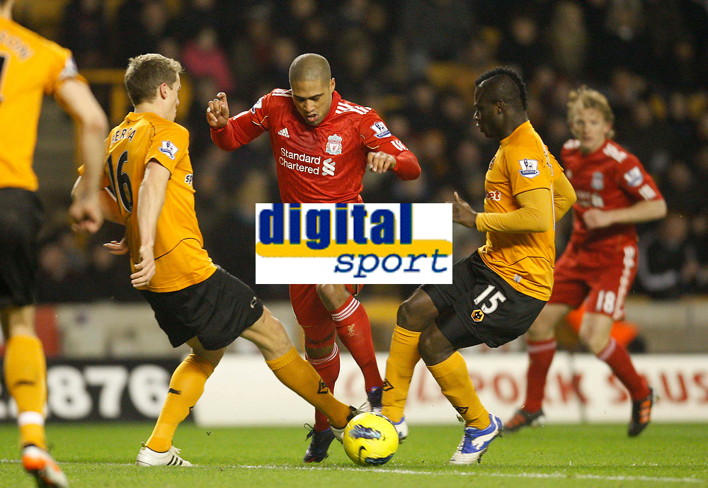 20120131: WOLVERHAMPTON, UK - Barclays Premier League 2011/2012: Wolverhampton Wanderers vs Liverpool.<br /> In photo: Glen Johnson of Liverpool falls under a challenge from Emmanuel Frimpong and Christophe Berra of Wolverhampton Wanderers but fails to earn a penalty kick.<br /> PHOTO: CITYFILES