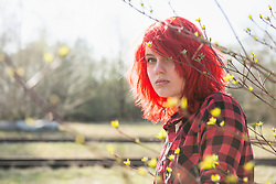 Shy teenage Punk girl fashion dyed bright red hair