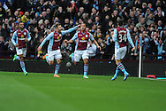 Aston Villa's Gabriel Agbonlahor(3rd from left) celebrates scoring his sides 1st goal during the Barclays Premier league, Aston Villa v Swansea city at Villa Park in Birmingham, England on Saturday 28th Dec 2013. <br /> pic by Jeff Thomas, Andrew Orchard sports photography.
