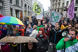 London, UK. 14 October, 2019. Climate activists from Extinction Rebellion decide to vacate the busy junction in front of the Bank of England which they had occupied since 7am on the eighth day of International Rebellion protests. Large numbers of police had arrived shortly before in order to attempt to clear the junction.