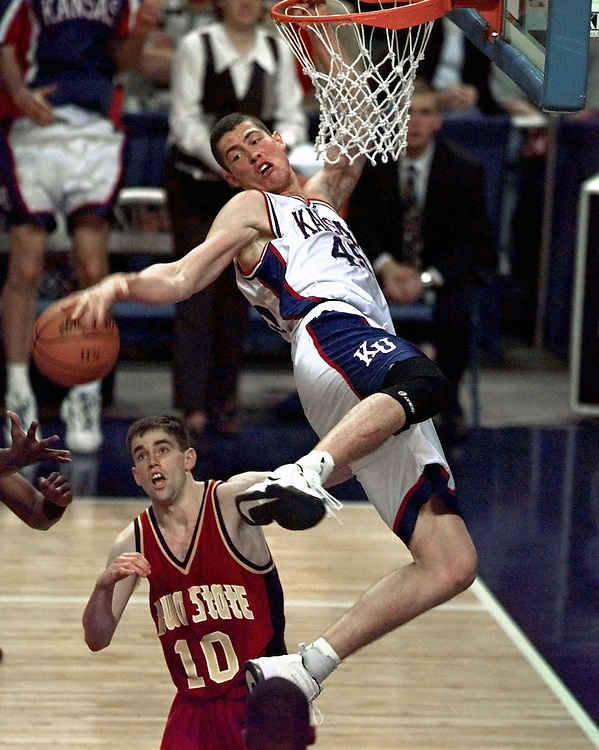 1997 Big 12 basketball tournament--- Kansas' Raef LaFrentz (45), top, hangs on the rim. At bottom is Iowa State's Jacy Holloway (10).
