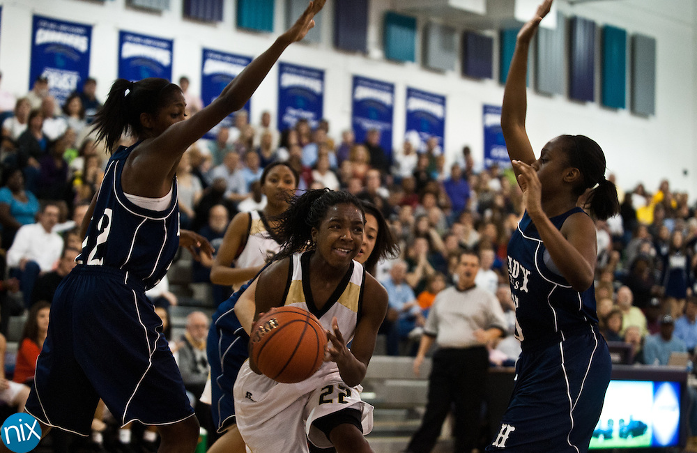 Concord's Jasmine DeBerry drives against Hickory Ridge during the championship game of the South Piedmont Conference Tournament Friday night. Concord defeated the Hickory Ridge 47-42. (Photo by James Nix)