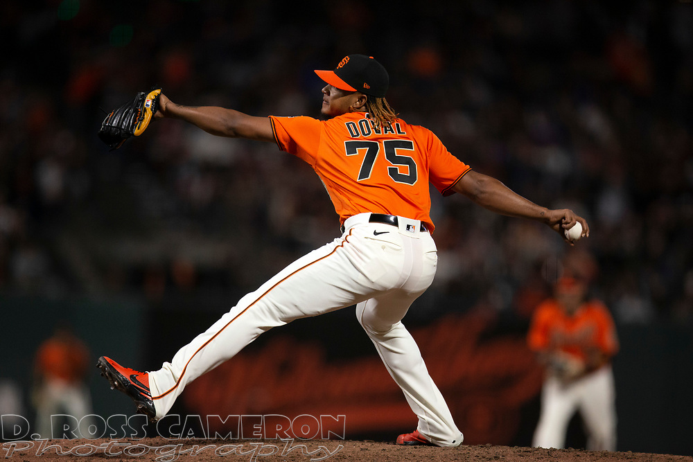 Oct 1, 2021; San Francisco, California, USA; San Francisco Giants pitcher Camilo Doval (75) delivers a pitch against the San Diego Padres during the ninth inning at Oracle Park. Mandatory Credit: D. Ross Cameron-USA TODAY Sports
