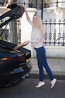 Leila Russack aka Miss Zagato out and about wearing  a  Bernice Angelique handbag,<br /> Paige denim and cute designer trainers photo by Terry Scott