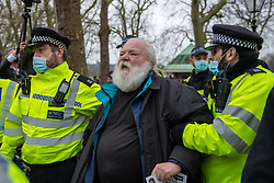© Licensed to London News Pictures. 20/03/2021. London, UK. A man is detained close to Speakers Corner at the anti-lockdown demonstration 'Worldwide Rally For Freedom' held in central London. Photo credit: Peter Manning/LNP