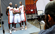 Dec. 12, 2011; Miami, FL, USA; Miami Heat small forward LeBron James (left) shooting guard Dwyane Wade (center) and power forward Chris Bosh (right) poses for a photographer during media day at American Airlines Arena. Mandatory Credit: Steve Mitchell