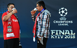 Fans enjoy a pre match drink outside the ground prior to the UEFA Champions League Final at the NSK Olimpiyskiy Stadium, Kiev.