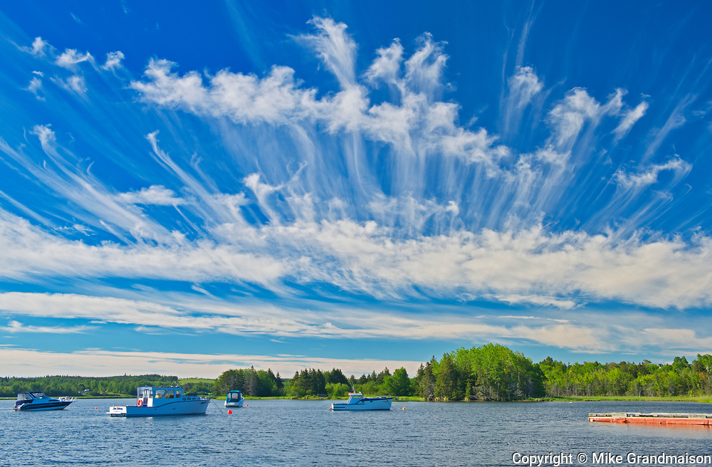 Clouds and boats on Cape Breton, North Sydney, Nova Scotia, Canada