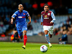 Elliot Omozusi of Leyton Orient and Kieran Richardson of Aston Villa compete for the ball - Photo mandatory by-line: Rogan Thomson/JMP - 07966 386802 - 27/08/2014 - SPORT - FOOTBALL - Villa Park, Birmingham - Aston Villa v Leyton Orient - Capital One Cup Round 2.