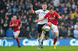 Nottingham Forest Defender Greg Halford (ENG) is challenged by Derby Midfielder Jeff Hendrick (IRL) during the first half of the match - Photo mandatory by-line: Rogan Thomson/JMP - Tel: Mobile: 07966 386802 19/01/2013 - SPORT - FOOTBALL - Pride Park - Derby. Derby County v Nottingham Forest - npower Championship. The meeting of these two local sides is known as the East Midlands Derby with the winner claiming the Brian Clough Trophy.