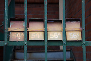 Folded steel painted letterbox on Harrington Street, a backstreet in the The Rocks, Sydney, Australia