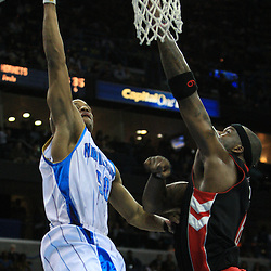 06 February 2009:  New Orleans Hornets guard Antonio Daniels (50) drives to the basket as Toronto Raptors center Jermaine O'Neal (6) defends the play during a 101-92 win by the New Orleans Hornets over the Toronto Raptors at the New Orleans Arena in New Orleans, LA.