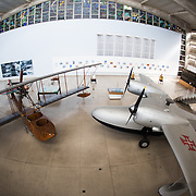 Seaplanes on display. The Museu de Marinha (Maritime Museum of Navy Museum) focuses on Portuguese maritime history. It features exhibits on Portugal's Age of Discovery, the Portuguese Navy, commercial and recreational shipping, and, in a large annex, barges and seaplanes. Located in the Belem neighborhood of Lisbon, it occupies, in part, one wing of the Jerónimos Monastery. Its entrance is through a chapel that Henry the Navigator had built as the place where departing voyagers took mass before setting sail. The museum has occupied its present space since 1963.