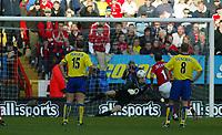 Photo. Chris Ratcliffe<br />Charlton v Arsenal. FA Premiership. 26/10/2003<br />Paulo Di Canio chips the ball over Lehmann to score Charlton's goal