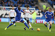 Lucas Piazon of Fulham © tries to go past Sol Bamba (l) and Aron Gunnarsson ® of Cardiff city. EFL Skybet championship match, Cardiff city v Fulham at the Cardiff city stadium in Cardiff, South Wales on Saturday 25th February 2017.<br /> pic by Andrew Orchard, Andrew Orchard sports photography.