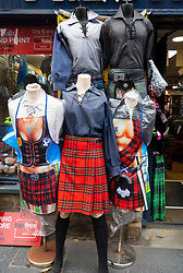 male mannequins wearing kilts outside tourist gift shop on the Royal Mile in Edinburgh, Scotland, UK.
