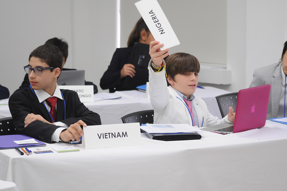 Foreign delegate of HRC MS raising his placard for attendance.