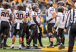 Nov 23, 2019; Morgantown, WV, USA; Oklahoma State Cowboys quarterback Dru Brown (6) in the huddle before a snap during the third quarter against the West Virginia Mountaineers at Mountaineer Field at Milan Puskar Stadium. Mandatory Credit: Ben Queen-USA TODAY Sports