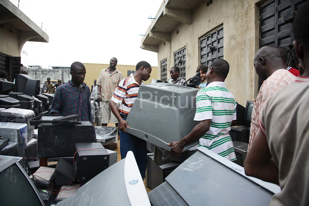 The TV tracked from the UK by Greenpeace has been identified amongst hundreds of newly arrived TVs from the UK. The TV is picked out and bought back by Greenpeace activists and brought back to London, UK.  Alaba International Market, one of the largest markets for electronic goods in West Africa.  New and old - and a lot of non-working electronic goods such as TVs and computers come in to the market via Lagos harbour from the US, Western Europe and China.This picture is part of an undercover investigation by Greenpeace and Sky News.  A TV-set originally delivered to a municipality-run collecting point in UK for discarded electronic products was tracked and monitored by Greenpeace using a combination of GPS, GSM, and an onboard radiofrequency transmitter placed inside the TV-set.  The TV arrived in Lagos in container no 4629416 and was found in Alaba International Market and bought back by Greenpeace activist. The TV was subsequently brought back to England and used as proof of illegal export of electronic waste. A number of individual are currently on trial in London in connection with illegal exports(Nov 2011)