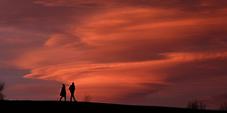 Lenticular clouds form behind the Angel of the North in Gateshead, Tyne and Wear.
