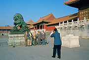 Tourists posing for photographs  in Forbidden City, Beijing, China