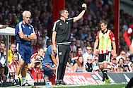 Marinus Dijkhuizen, the Brentford © head coach giving directions to his players from the touchline. Skybet football league Championship match, Brentford v Ipswich Town at Griffin Park in London on Saturday 8th August 2015.<br /> pic by John Patrick Fletcher, Andrew Orchard sports photography.