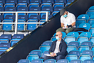 Journalists with face masks in the stands during the EFL Sky Bet Championship match between Queens Park Rangers and Barnsley at the Kiyan Prince Foundation Stadium, London, England on 20 June 2020.