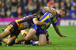 Warrington Wolves' Jack Hughes  is taken down during the 2017 Dacia World Club Series match at the Halliwell Jones Stadium, Warrington. PRESS ASSOCIATION Photo. Picture date: Saturday February 18, 2017. See PA story RUGBYL Warrington. Photo credit should read: Dave Howarth/PA Wire. RESTRICTIONS: Editorial use only. No commercial use. No false commercial association. No video emulation. No manipulation of images.