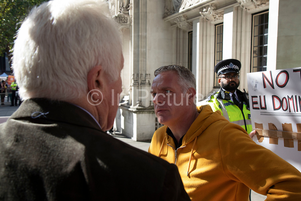 Television presenter and broadcaster David Dimbleby speaks to pro-leave protesters outside The Supreme Court as the first day of the hearing to rule on the legality of suspending or proroguing Parliament begins on September 17th 2019 in London, United Kingdom. The ruling will be made by 11 judges in the coming days to determine if the action of Prime Minister Boris Johnson to suspend parliament and his advice to do so given to the Queen was unlawful. David Dimbleby is a British journalist and former presenter of current affairs and political programmes, now best known for the BBCs long-running topical debate programme Question Time.