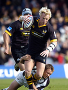 Wycombe. GREAT BRITAIN, 10th October 2004, Guinness Premiership Rugby, London Wasps and Newcastle Falcons, Adams Park, ENGLAND. [Mandatory Credit; Pete Spurrier/Intersport-images]<br /> <br /> Wasps Peter Richardson, is tackled low by, Falcons, Jonny Wilkinson
