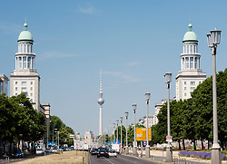 View along famous Karl Marx Allee towards Frankfurter Tor and television tower or Fernseturm at Alexanderplatz in former East Berlin Germany