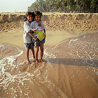 Vijyashree Viswanathan (age 7, left), and sister Vijitha (age 9, right) stand on the shore close to the point where Vijitha and Vijashree's mother and brother lost their lives. This is the first occasion since the tsunami, that Vijitha and Vijyashree have ventured close to the sea.<br />