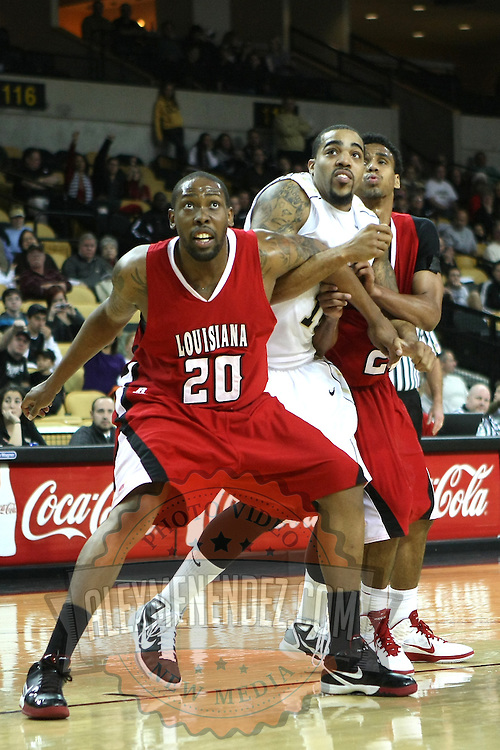 Louisiana's center Courtney Wallace (20) blocks out Central Florida forward Dwight McCombs (10) during their game at the UCF Arena on December 15, 2010 in Orlando, Florida. UCF won the game79-58. (AP Photo/Alex Menendez)