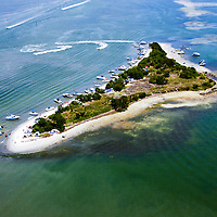 Intracoastal waterway, deepened by dredge, the sand creates spoil islands.