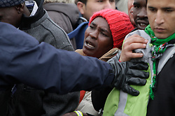 October 24, 2016 - Calais, Nord-Pas-de-Calais-Picardie, France - A police officers bushes refugees back. A minor scuffles with some pushing and shoving broke out between refugees queueing to get into the Reception and Orientation Centre at the Jungle and police officers. (Credit Image: © Michael Debets/Pacific Press via ZUMA Wire)